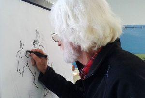 Enric Larreula dibuixant a les escoles